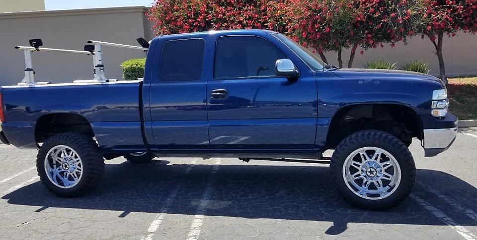 Jesses Silverado with 20x10 Chrome Lonestar Outlaw Wheels