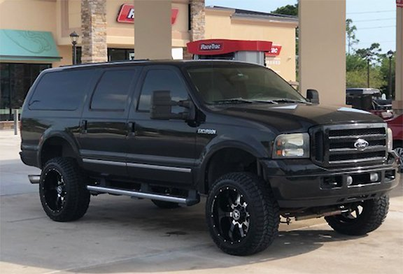 Warrens Ford Excursion with 20x10 Lonestar Gunslingers